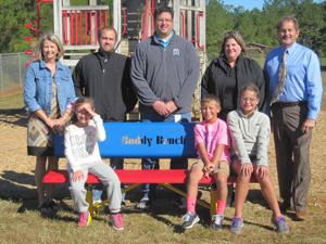 "<p>Armuchee Elementary School has new ""Buddy Benches."" Pictured with a new bench are: (from left) front row third-grade student Ivey Whitaker, fourth-grade student Henry Foss and fifth-grade student Reagan Foss.  Back row: Carol Burris, AES counselor; Lowe's representatives Cliff Flagello, Penny Evans and Mark Schwarz; and Rodney Stewart, AES principal. (Contributed photo)</p>"