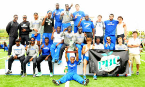 <p>The Shorter men celebrate after winning the Peach Belt Conference Championships on Saturday at Barron Stadium.</p>
