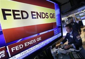 Fed keeps rate at record low, ends bond buying