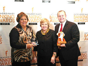 <p><strong>From left:</strong>Accepting the award on behalf of First Volunteer are Mary Carpenter; Patti Steele, president and CEO and Mike Johnson.</p>