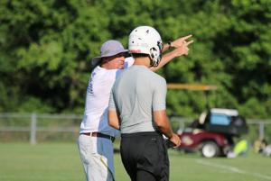 <p>Darlington head football coach Tommy Atha (left) gives instructions to quarterback Cameron Evans during a session at the Darlington 7-on-7 Passing Camp on Thursday, June 16, 2016. (Jeremy Stewart/RN-T.com)</p>