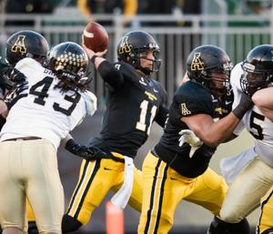<p>Appalachian State quarterback Taylor Lamb (center) makes a throw during a recent game. (Andrew Dye, Winston-Salem Journal)</p>
