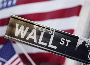 <p>FILE - This Aug. 9, 2011 file photo shows a Wall Street street sign near the New York Stock Exchange, in New York. (AP Photo/Mark Lennihan, File)</p>