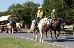 <p>Billy Puryear (left) and Peyton Hamilton lead the annual John Wisdom Wagon Train and Trail Ride on Saturday. (Doug Walker, RN-T)</p>