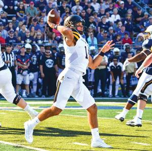 <p>Appalachian State quarterback Taylor Lamb throws downfield during Saturday's game at Akron. (Allyson Lamb, Appalachian State Athletics)</p>