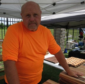 <p>Randy Hallman of Chickamauga starting making cutting boards five years ago after trying other items and found his niche. (Catoosa News photo/Tamara Wolk)</p>