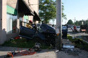 SUV hits pole