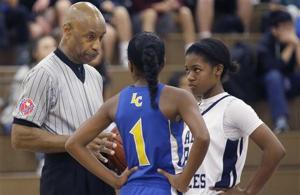 <p>In this Thursday, Nov. 12, 2015, photo, Spenser Simmons, left, a referee with the North Texas Basketball Officials Association, speaks to players during a high school freshman girls basketball game in Allen, Texas. Violence against referees is as old as sport itself, and most are familiar with awful scenes from lower-division soccer matches in Europe and South America to peewee games and high school tournaments in the United States. This has come at a cost: By all accounts from those involved, finding and retaining referees is becoming more and more difficult. (AP Photo/LM Otero)</p>