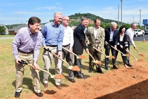<p>Tim Baucom (from left), Shaw; Jeff West, Patcraft; John Stephens, Shaw; Randy Merritt, president of Shaw; Matt Santini, mayor of Cartersville; Bob Chandler, Shaw; Brenda Knowles; Shaw and Hal Long of Shaw break ground for the new Create Centre.  The company is investing $24 million in the new center of innovation. (Photo contributed)</p>