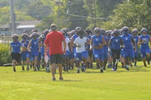 <p>Model High head coach Gordon Powers leads his team during practice Wednesday afternoon. (John Burns, RN-T)</p>