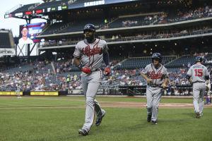 Heyward helps Braves edge Mets, 3-2