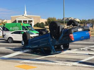 Truck overturns in wreck