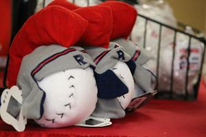 <p>A table displaying Rome Braves merchandise was part of the annual Hot Stove Gathering at The Forum on Monday, Jan. 25, 2016. (Jeremy Stewart/RN-T.com)</p>