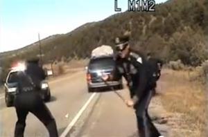 Officer fires at minivan