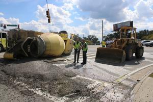 Cement truck wrecks, sends driver to FMC