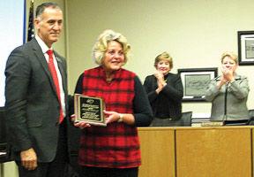 <p><span>Walker County schools superintendent Damon Raines honors board chairwoman Susan Wells during her last meeting on Dec. 15. (Catoosa News photo/Natasha Colbaugh)</span></p>
