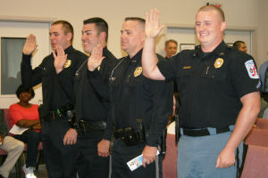 Rome police officers receive promotions, SWAT pins