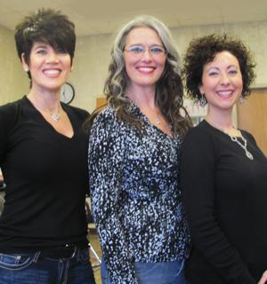 <p>Gwent Tant, middle, is owner of Tangles Beauty Salon in Rockmart. Other hair stylists are Shani Robinson and Melissa Strickland.</p>