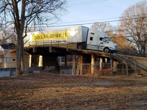 Dollar General truck gets stuck on College Street bridge