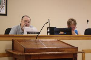 <p>Mayor Pro Tem Duel Mitchell read from the city's latest measure to re-open qualifying for the mayor's race in the coming special election in November.</p>