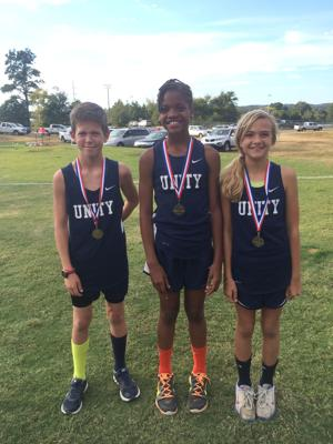 <p>Unity Christian School runners Huston Bryant (from left), Kara Dunn and Julia Yadkowski competed in the middle school championships for the Lions. (Contributed photo)</p>