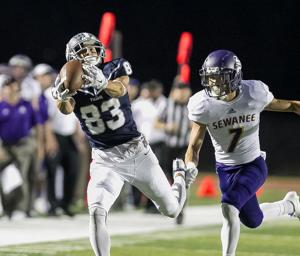 <p>Trey Ciresi (left) hauls in a catch past Sewanee's Micah Maes during Saturday's game at Valhalla. The Vikings won 41-3 to improve to 4-0. (Steven Eckhoff / Rome News-Tribune)</p>