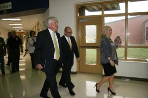 <p>(from left) Polk School District superintendent William Hunter and state school superintendent John Barge follow Van Wert Elementary principal Shannon Hulsey during a tour Tuesday morning.</p>