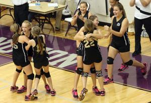 <p>Coosa celebrates after winning the FCAA Volleyball Tournament championship at Darlington.</p>
