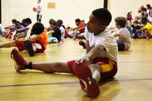 <p>Stretching helps young athletes avoid injury. (Georgia Health News photo)</p>