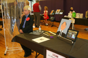 <p>Connor Brown portrays Sir Alfred Hitchcock Thursday during Darlington's annual student wax museum. (Kristina Wilder / Rome News-Tribune)</p>