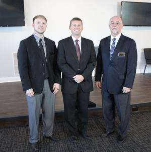 <p>Chris Miller, Norman Smith and Steve Miller gathered for a photo in the chapel of the new Smith and Miller Funeral Home in Cedartown, located on North Main Street in the newly renovated State Patrol barracks. (Kevin Myrick/SJ)</p>