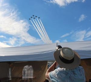 <p>Tom Reimer, a Savannah Morning News photographer, takes a picture of the U.S. Air Force Thunderbirds as they fly over Richard B. Russell Regional Airport during the Wings Over North Georgia air show.(Carolyn Grindrod, RN-T)</p>