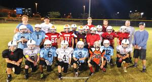 <p>Sonoraville High players Tate Moore, Russell Johnson, Bailey Reece and Trent Holley pose for a photo with the Gordon County 9-10 year old team during a recent practice. (Contributed Photo)</p>
