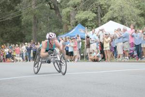 <p>Tatyana McFadden finished the Cedartown Wheelchair 5K with a time of 11:11.57 for first place. (Kevin Myrick / Standard Journal)</p>