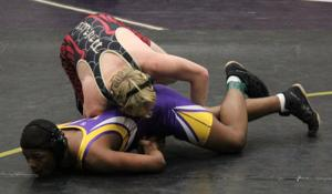 <p>Aaron Brown (bottom) and Bryce Eickleberry wrestle at Pepperell High School on Saturday, Dec. 20, 2014. Aaron Brown is a freshman at Villa Rica and Bryce Eickleberry is a junior at Pepperell. (Sierra Campbell/Rome News-Tribune)</p>