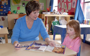 <p>SuperKids Early Learning Center owner Debra McDaniel reads to Bailey Broderson, 4-year old daughter of Paul and Michelle Broderson of Rome. (Doug Walker, RN-T)</p>