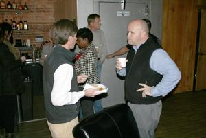 <p>Harry Brock (left) talks about real estate activity in Rome with City Manager Sammy Rich at the Coffee Break. (Doug Walker, RN-T)</p>