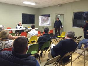 <p>Community members at public meeting Thursday listen to the master plan for new park property adjacent to Memorial Park in Calhoun.</p>