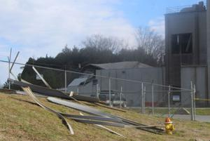 <p>Debris landed outside of the fence at JCG Farms Feed Mill in Rockmart after an explosion. (Kevin Myrick/SJ)</p>