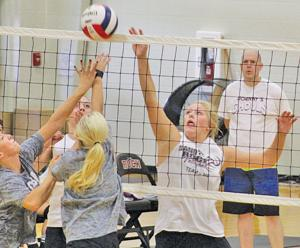 <p>Sand Rock's Haylie Pruitt, right, attempts to put the ball over the net against Coosa Christian in a volleyball scrimmage on Friday. Photo by Shannon Fagan.</p>