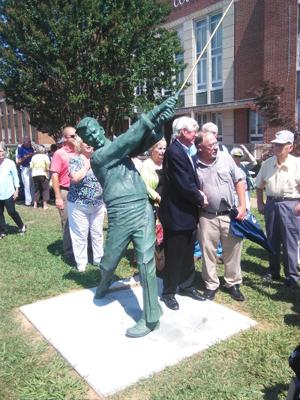 <p>Doug Sanders (left) poses for a photograph with former Cedartown city commissioner Gary Martin next to his statue at the Polk County Sports Walk of Fame unveiling on Saturday, June 25, 2016. (Kevin Myrick/Polk County Standard Journal)</p>