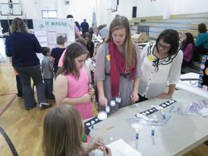 <p>Shorter University teacher candidates Megan Clark and Amber Davis help Pepperell Elementary School students with activities aimed at increasing science skills at the elementary school. Shorter University's School of Education and Pepperell Elementary School have formed a partnership through the help of a recent grant.</p>
