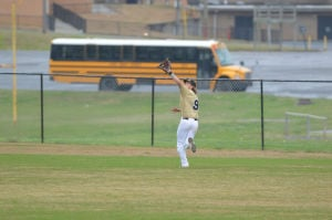 <p>Calhoun center fielder Logan Walraven goes back to make a catch during Friday's game at Coosa.</p>