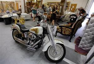 "<p><span id=""_oneup"" style=""font-size: 12px;"">Shoppers look over the some of the many items available, including a motorcycle, at an estate sale from The Holy Land Experience religious theme park, Thursday, July 21, 2016, in Orlando, Fla. The Christian theme park is holding the sale amid declining revenue and contributions. The sale starts Thursday and lasts through Saturday. (AP Photo/John Raoux)</span></p>"