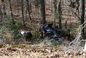 <p>This Toyota Tercel slid down an embankment off Rockmart Highway after colliding with two other vehicles Tuesday morning, Nov. 25, 0214. Bystanders ran to the vehicle and used extinguishers to put out a fire in the car. (Alan Riquelmy/RN-T.com)</p>