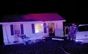 <p>A car (not visible in photo) went off the side of the road shortly before 7:30 p.m. and hit the front of this house at 4109 Black's Bluff Road before overturning in the side yard. (Diane Wagner / Rome News-Tribune)</p>