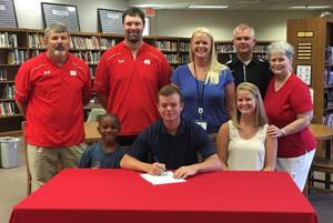<p>Rome's Jacob Harrell (seated, center) recently signed to play baseball at Georgia Southwestern State University in Americus. Joining him are his brother Tyler Harrell (seated, from left), his sister Megan Harrell, Rome High pitching coach Dave Williams (standing, from left), head coach Michael Dougherty, his mother Cara Harrell, his father Brandan Harrell and his grandmother Linda Whisenant. (Contributed photo)</p>