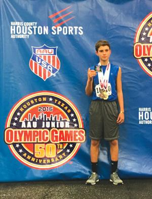 <p>Dylan Faulkner poses with his medals at the AAU Junior Olympics in Houston. (Contributed Photo)</p>