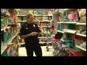 Children get to pick toys for Christmas in annual 'Shop with a Cop' program
