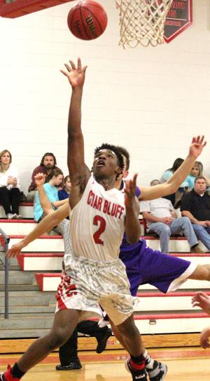 <p>Cedar Bluff's Isaiha Jones goes airborne for a basket against Gaylesville on Tuesday. Photo by Shannon Fagan.</p>